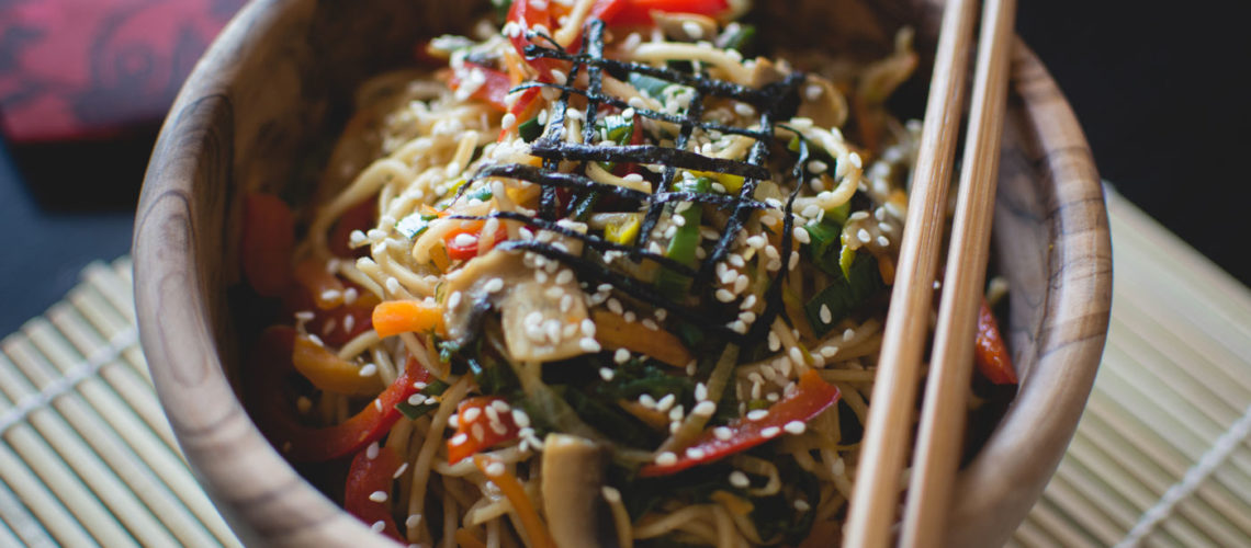 Pan-fried noodles with tomatoes, and sesame seeds